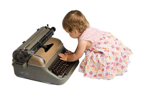 Little writer, child typing